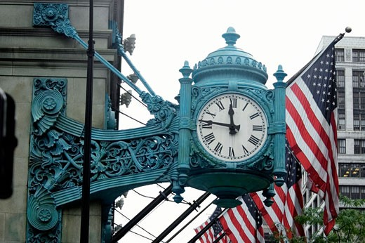 Low angle view of a clock on a building, Marshall Field's Building, Chicago, Illinois, USA : Stock Photo