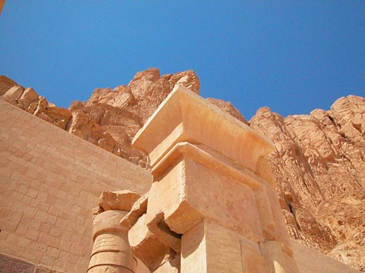 Low angle view of columns in front of a stone wall, Egypt : Stock Photo