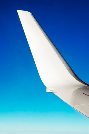 Close-up of an airplane wing in flight : Stock Photo