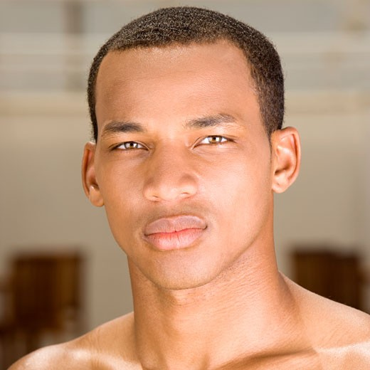 Portrait of a young man looking serious : Stock Photo