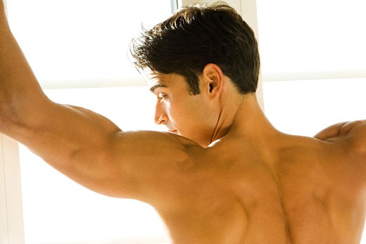 Rear view of a young man looking sideways : Stock Photo
