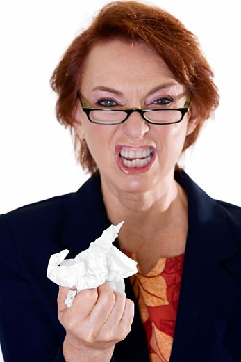 Stock Photo: 1663R-40569 Portrait of a businesswoman crushing paper