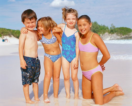 Close-up of a boy and his three sisters on the beach, Bermuda : Stock Photo
