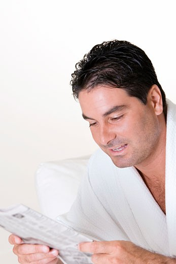 Stock Photo: 1663R-43307 Close-up of a mid adult man reading a newspaper
