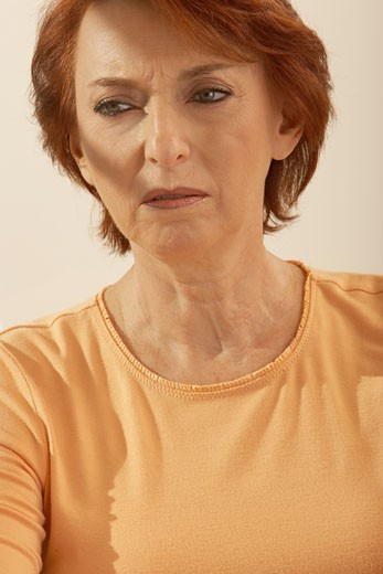Close-up of a senior woman looking worried : Stock Photo