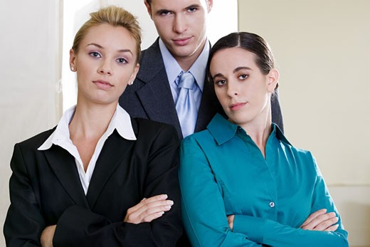 Stock Photo: 1663R-44046 Portrait of two businesswomen standing with a businessman
