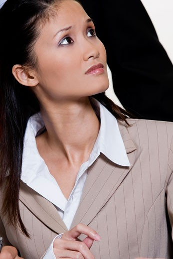 Close-up of a businesswoman looking up : Stock Photo