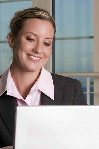 Close-up of a businesswoman in front of a laptop : Stock Photo