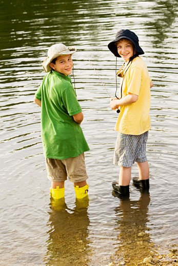 Stock Photo: 1663R-45032 Rear view of two brothers fishing near a lake