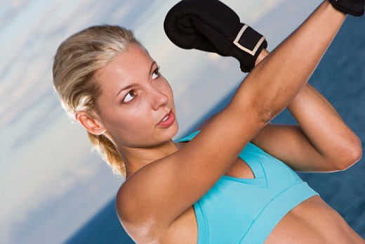 Close-up of a young woman boxing : Stock Photo
