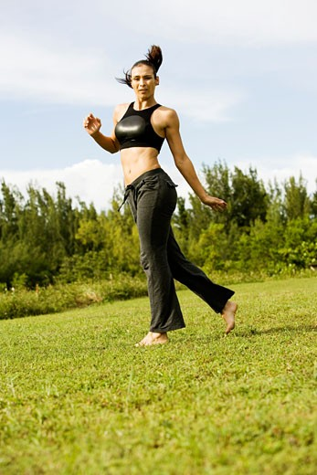 Stock Photo: 1663R-45147 Young woman practicing martial arts
