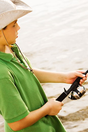 Stock Photo: 1663R-46318 High angle view of a teenage boy fishing in a lake