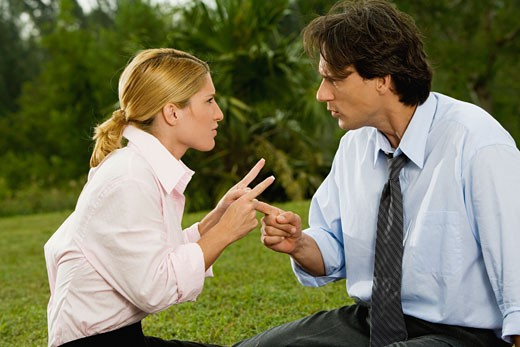 Stock Photo: 1663R-46676 Mid adult man arguing with a young woman