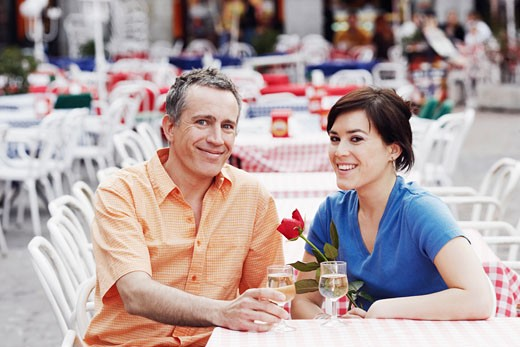 Stock Photo: 1663R-4686 Portrait of a mature man and a young woman sitting together at a sidewalk cafe