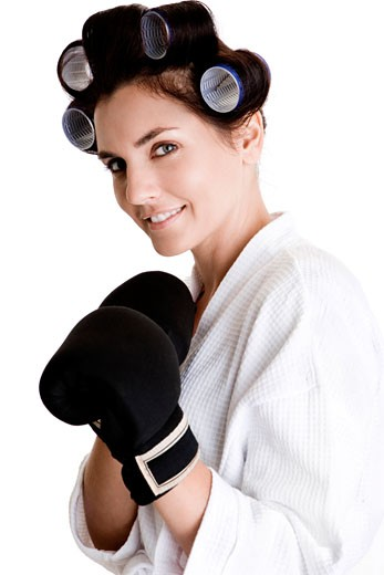 Portrait of a young woman wearing boxing gloves : Stock Photo