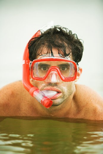 Stock Photo: 1663R-47606 Portrait of a young man wearing a scuba mask