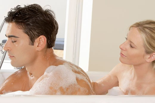 Stock Photo: 1663R-48064 Close-up of a young couple in a bathtub