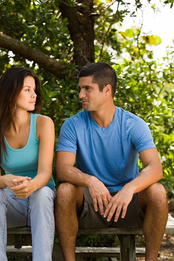 Stock Photo: 1663R-48200 Young woman and a mid adult man looking at each other