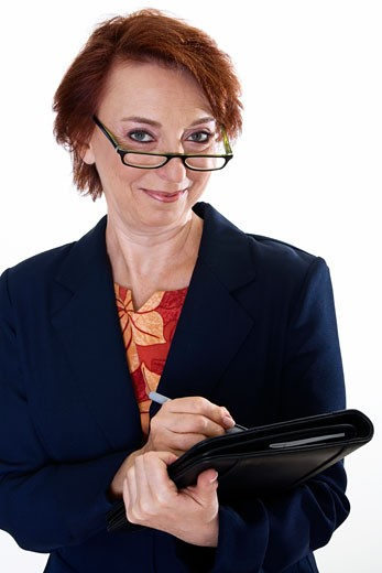 Stock Photo: 1663R-48253 Portrait of a businesswoman holding a file