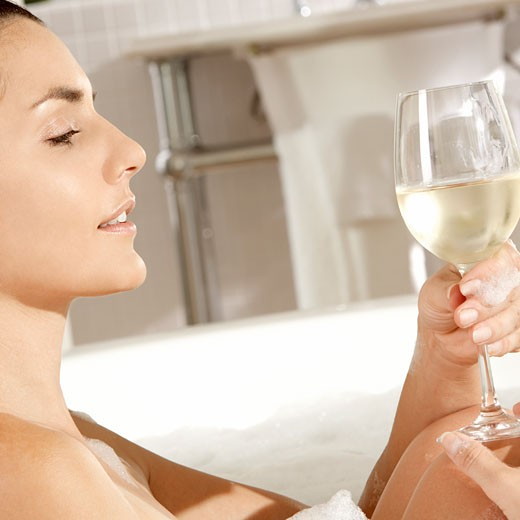 Stock Photo: 1663R-48967 Close-up of a young woman holding a glass of wine in a bathtub
