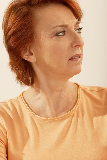 Close-up of a senior woman thinking : Stock Photo