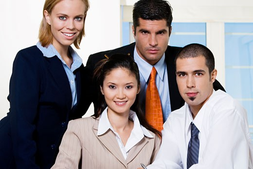 Portrait of two businessmen and two businesswomen : Stock Photo