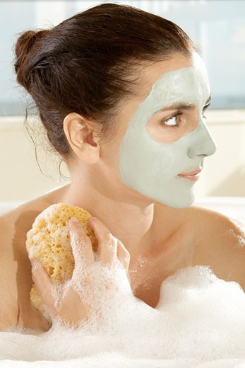 Stock Photo: 1663R-49480 Close-up of a young woman scrubbing herself with a sponge