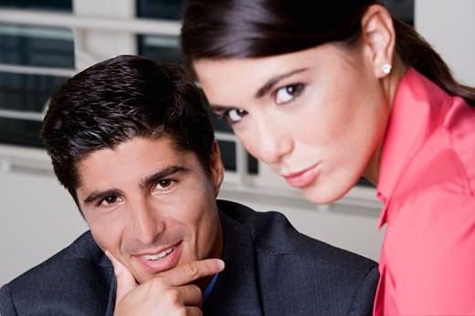 Portrait of a businessman and a businesswoman : Stock Photo
