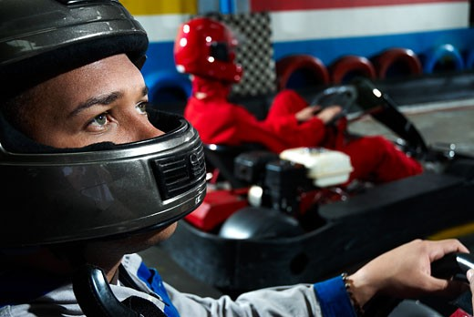 Stock Photo: 1663R-50646 Close-up of a male go-cart racer in a sports car