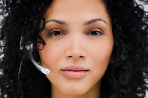 Stock Photo: 1663R-51183 Portrait of a female customer service representative wearing a headset