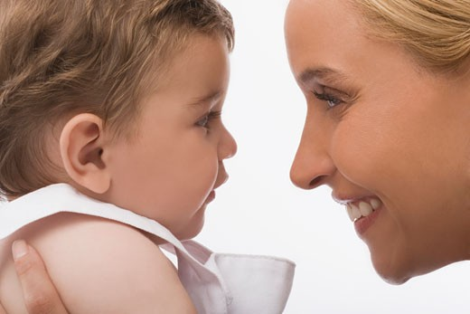 Stock Photo: 1663R-51605 Close-up of a mid adult woman smiling with her son
