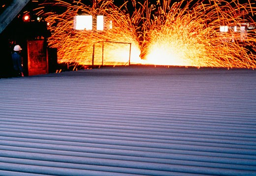 Close-up of a metal sheet in a steel mill : Stock Photo