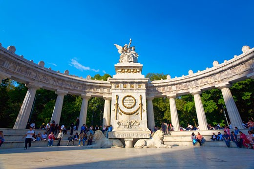 Low angle view of a monument in front of colonnade, Hemiciclo a Benito Juarez, Mexico city, Mexico : Stock Photo