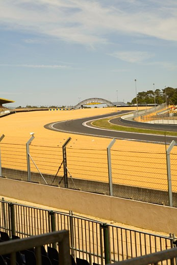 Stock Photo: 1663R-53995 Chain-link fence along with motor racing tracks in a field, Le Mans, France