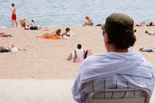 Rear view of a man on the beach, Plage de la Croisette, Cote d'Azur, Cannes, Provence-Alpes-Cote D'Azur, France : Stock Photo