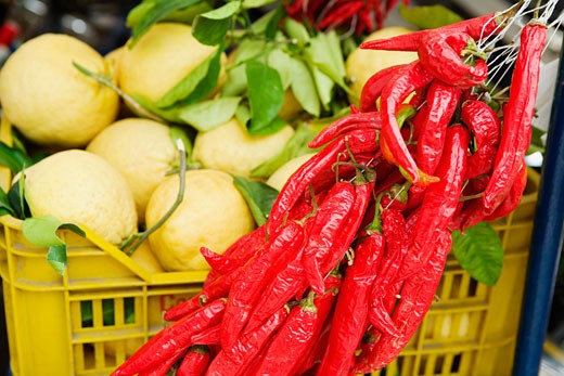 Red chili peppers with guavas at a market stall, Sorrento, Sorrentine Peninsula, Naples Province, Campania, Italy : Stock Photo