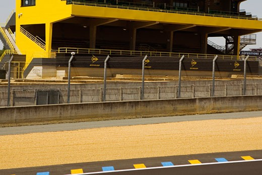 Chain-link fence along with motor racing track, Le Mans, France : Stock Photo