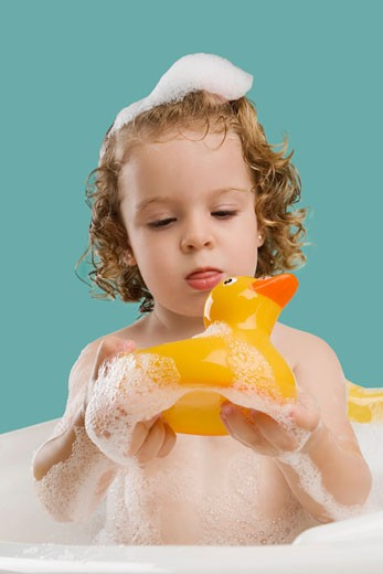 Stock Photo: 1663R-55339 Close-up of a girl holding a rubber duck