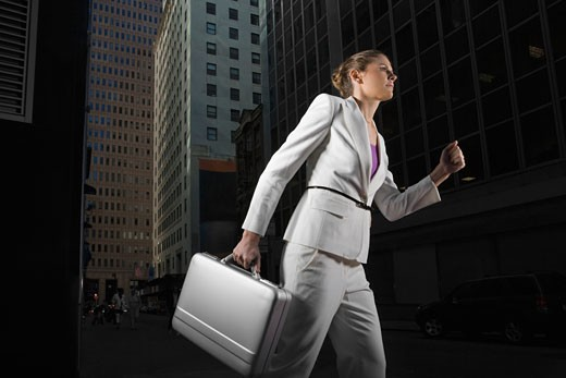 Low angle view of a businesswoman carrying a briefcase : Stock Photo