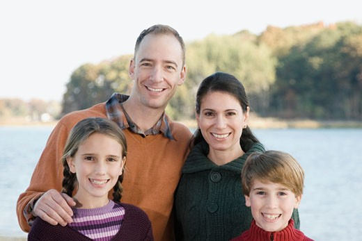 Stock Photo: 1663R-56150 Portrait of a family smiling