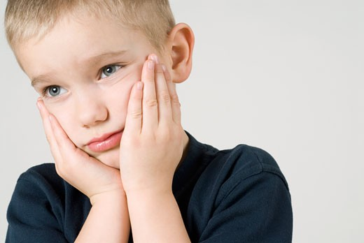 Stock Photo: 1663R-56450 Close-up of a boy looking sad