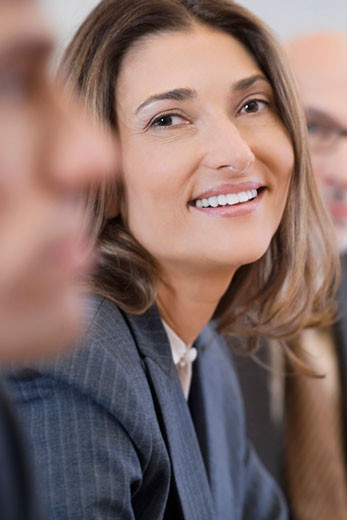 Portrait of a businesswoman smiling in a board room : Stock Photo