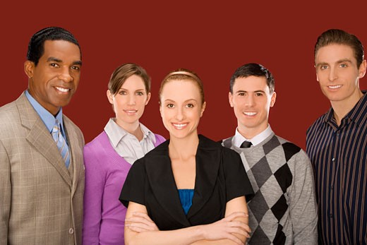 Portrait of business executives standing together and smiling : Stock Photo