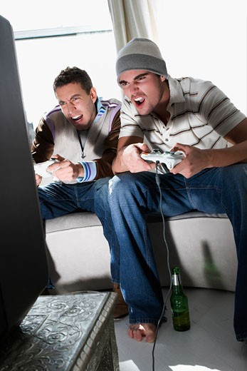 Stock Photo: 1663R-58489 Young men playing a video game