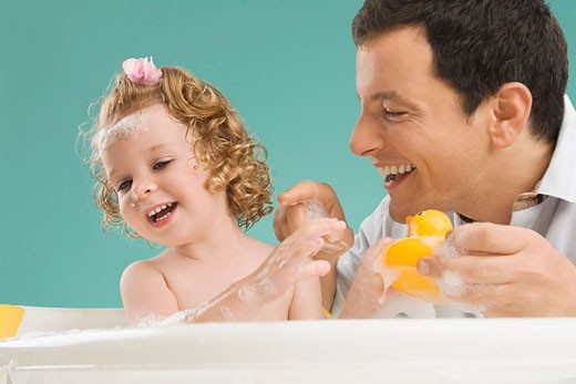 Mid adult man playing with his daughter : Stock Photo