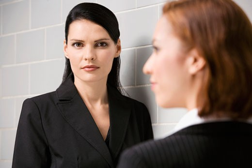 Portrait of a businesswoman with another businesswoman standing in front of her : Stock Photo