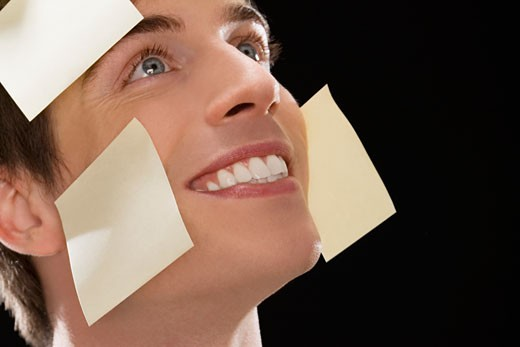 Stock Photo: 1663R-58908 Close-up of a businessman covered with adhesive notes and day dreaming