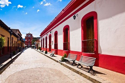 Buildings on both sides of a street, San Cristobal De Las Casas, Chiapas, Mexico : Stock Photo