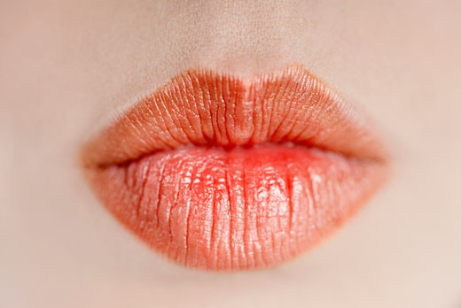Stock Photo: 1663R-6018 Close-up of a young woman's lips
