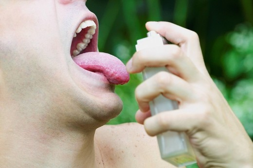 Stock Photo: 1663R-60680 Close_up of a young man spraying perfume on his tongue